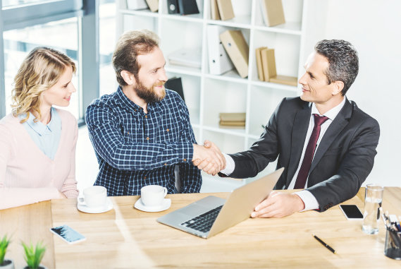 couple and businessman on agreement